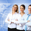 Three successful young business persons together — Stock Photo #9901415