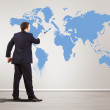 Businessman with paint brush and world map — Stock Photo