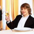 Young handsome man sitting in restaurant - Stock Photo