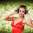 Young woman in evening dress with headphones — Stock Photo #9902019
