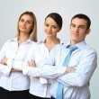 Three successful young business persons together — Stock Photo #9902334