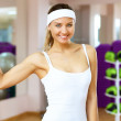 Woman in sport wear doing sport in gym — Stock Photo