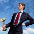 Young businessnman with award — Stock Photo #9908297