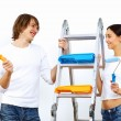 Royalty-Free Stock Photo: Young couple with paint brushes together