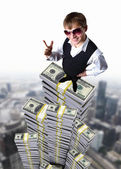 Young businessman with money symbols — Stock Photo