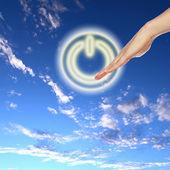 Przycisk zasilania na tle nieba — Zdjęcie stockowe