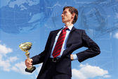 Young businessnman with award — Stock Photo