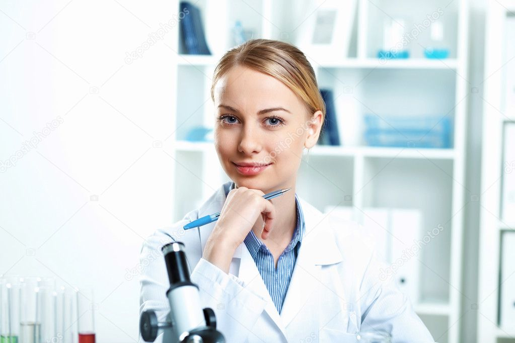 Young scientist in white uniform working in laboratory — Stock Photo #9901729