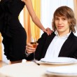 Young handsome man sitting in restaurant - 