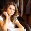 Young pretty woman sitting in restaurant — Foto de Stock
