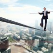 Business man balancing on the rope — Stock Photo #9916842