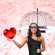 Pretty young woman with umbrella and hearts — Stock Photo #9916871