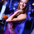 Young woman having fun at nightclub disco — Stock Photo #9917765