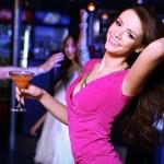 Young woman having fun at nightclub disco — Stock Photo #9917786