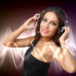 Stock Photo: Young woman in evening dress with headphones