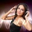 Young woman in evening dress with headphones — Stock Photo