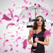 Pretty woman under umbrella with petals around her — Stock Photo #9917897