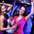 Young woman having fun at nightclub disco — Stock Photo #9918206