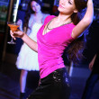 Young woman having fun at nightclub disco — Stock Photo #9918247