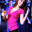 Young woman having fun at nightclub disco — Stock Photo #9918285