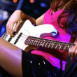 Young guitar player performing in night club — Stock Photo #9918394