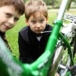 Boy on a bicycle in the green park — Stock Photo #9918418