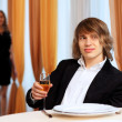 Young handsome man sitting in restaurant — Stock Photo #9918626
