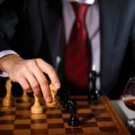 Businessman playing chess — Stock Photo #9918851