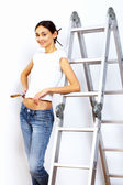 Young woman with paint brushes — Stock Photo
