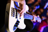 Young guitar player performing in night club — Stock Photo