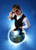 Young businessman and our planet earth — Stock Photo