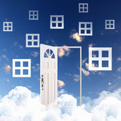 White door against blue sky background — Stock Photo