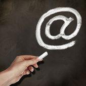 School blackboard and email symbol — Stock Photo