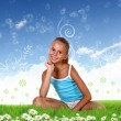 Smiling girl on green grass — Stock Photo