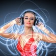 Young woman in evening dress with headphones — Stock Photo #9936962