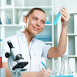 Young scientist working in laboratory - Stock Photo