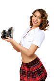 Woman dressed in retro style with camera — Stock Photo