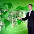 Young man against world map background — Stock Photo