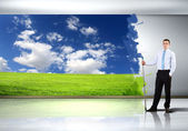 Young businessman and nature background — Stock Photo