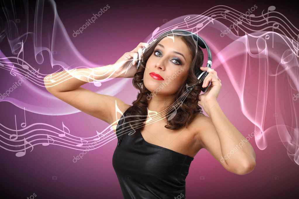 Portrait of young woman in evening dress with headphones — Stock Photo #9965076
