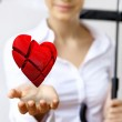 Woman with a red heart in her hand — Stock Photo