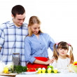 Family with a daughter cooking together at home — Stock Photo #9985403