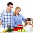 Family with a daughter cooking together at home — Stock Photo