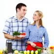 Husband and wife together coooking at home - Photo