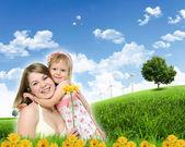 Collage met kinderen en ouders over groen gras — Stockfoto