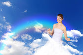 Woman against blue sky background — Stock fotografie
