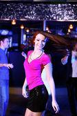 Young woman having fun at nightclub disco — Stock Photo