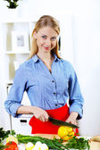 Woman cooking fresh meal at home — Stock Photo