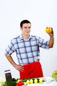 Man cooking fresh meal at home — Stock Photo