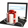 Laptop and gift — Stock Photo